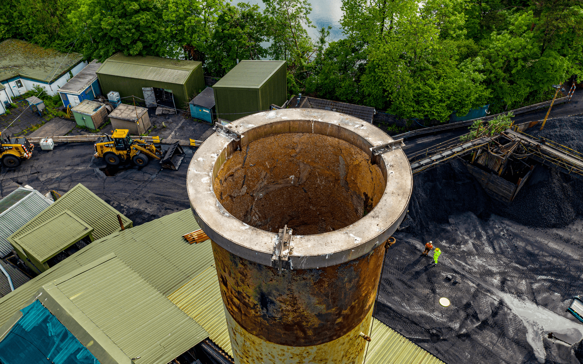 """Mavic 2 Pro"" aerial drone photo of a chimney stack conducting an aerial roof survey for ""Maxibrite"" in Llantrisant, Wales"