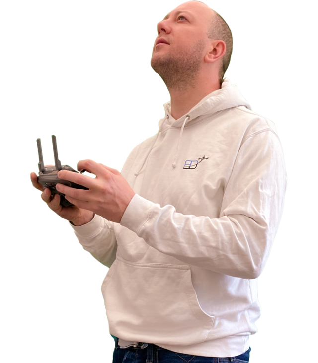 "body shot photo of Philippe Francken wearing a Bristol Drones hoody and holding a ""DJI"" ""Mavic 2 Pro"" drone remote controller"