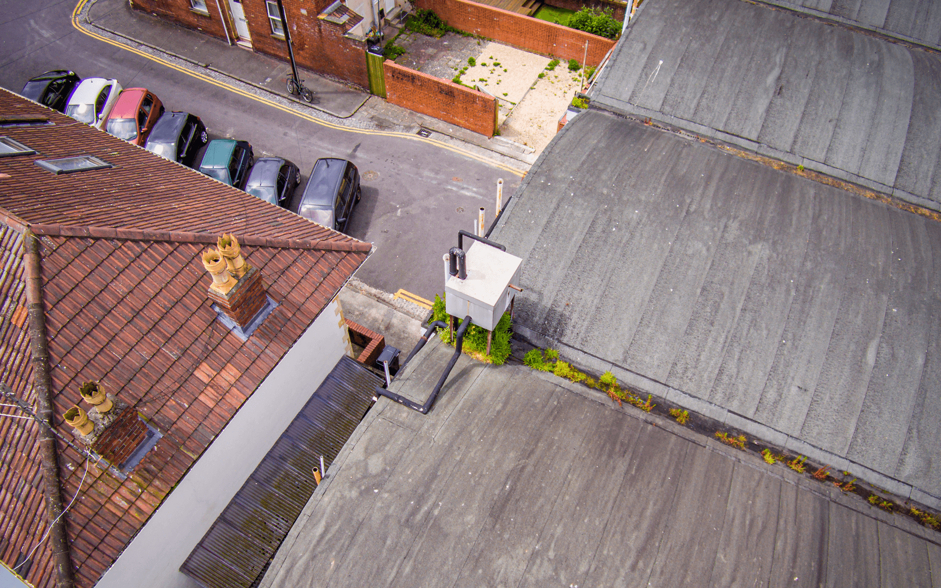 """DJI Inspire 1"" aerial drone photo for a roof survey in Bedminster, Bristol showing an air conditioning unit"