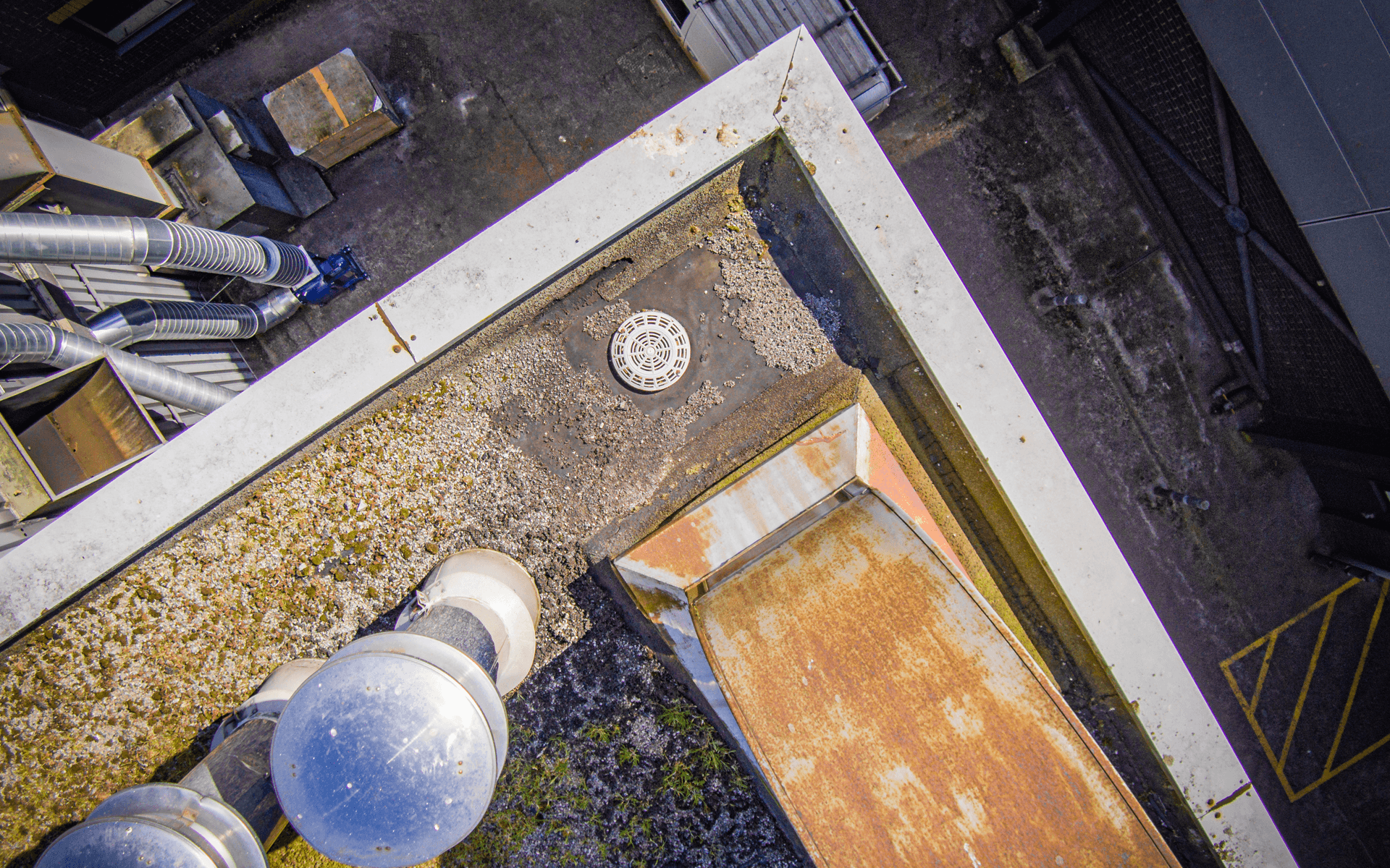 """DJI Inspire 1"" aerial drone photo for a roof survey in Midsomer Norton showing a drain and chimneys"
