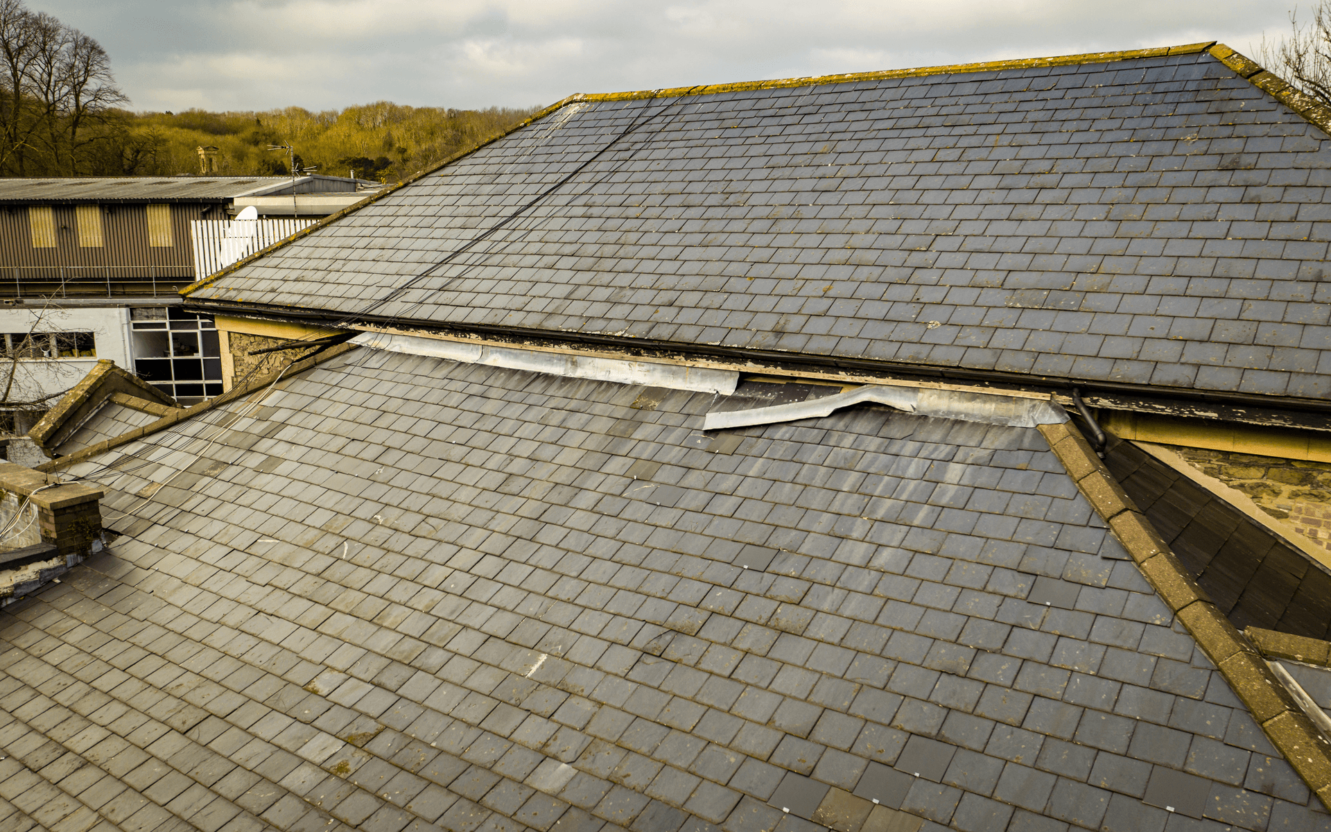 """Mavic 2 Pro"" aerial drone photo for a roof survey at ""Arnos Manor Hotel"" showing damage to the roof"